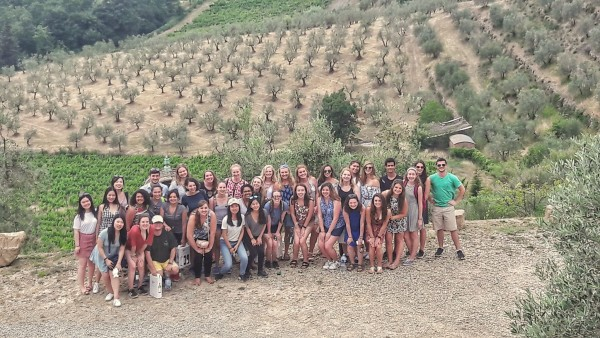 Posing for a group photo in Chianti after a wine tasting