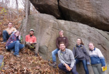 The Up-and-Away team, part of the 2017 Geological Field Methods course, on a steep Blue Ridge slope in front of a spectacular outcrop of meta-conglomerate and meta-arkose. These rocks are part of the Edicaran Swift Run Formation.
