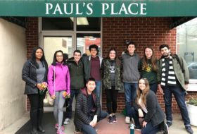"10 W&M students on a ""Branch Out Alternative Breaks"" trip pose in front of Paul's Place in Baltimore, MD"