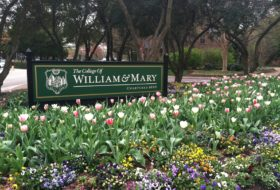 The College of William & Mary sign in a bed of flowers