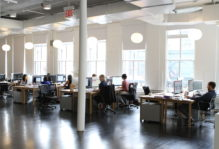 Employees seated at their desks in the office for Trollback+Company