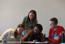 students working together on a poster