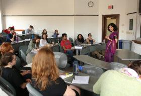 a professor lecturing a small class