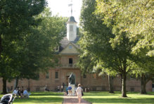visitors to campus walking around the Wren Yard in front of the Wren Building and Lord Bot statue