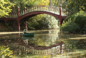 Female student in a canoe on Crim Dell in early fall