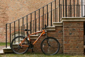 a bike leaned up against a brick stairwell