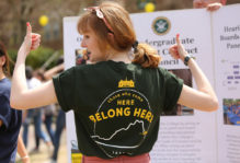 Female student at Day for Admitted Students wearing a 'those who come here belong here' tshirt