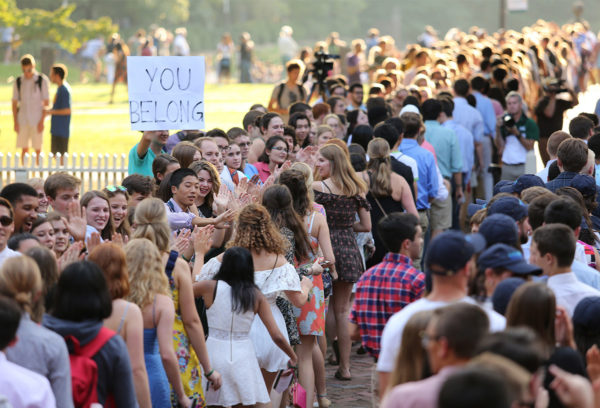students progressing through high-five line at Opening Convocation