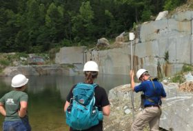 W&M geologist George Denny with a portable magnetometer at a dimension stone quarry in central Virginia.