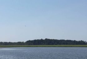 Nayses Bay, Virginia. Note osprey in mid-flight.