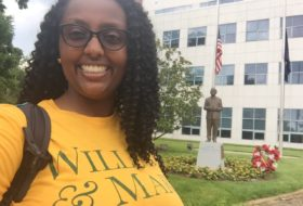 William and Mary student takes a selfie in front of a statue