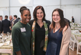 President Rowe poses with two scholarship recipients