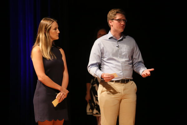 Two students presenting on stage for Shark Tank