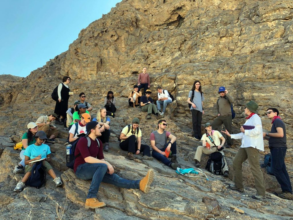 Professor Anne Rasmussen waxes lyrical about wadis with Permian limestone forming the back drop.