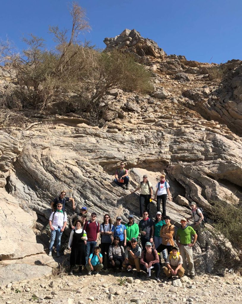 A splendid asymmetric fold framing the 2019 Rock Music Oman class in Wadi Mayh.