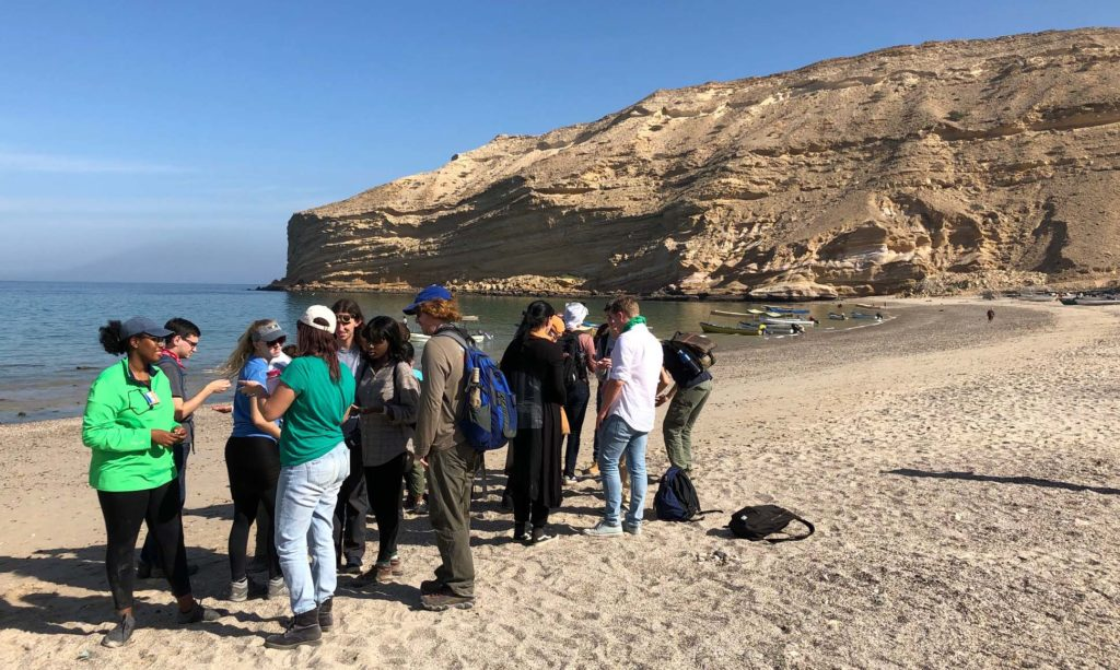 William & Mary students investigate the mysterious and magical sand on the beach at Qantab, Oman.