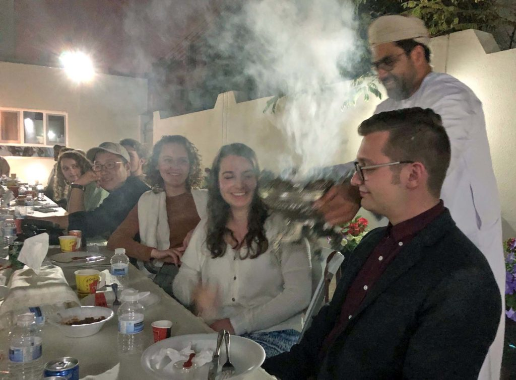 Dr. Sultan Al Farsi brings on the smoky and fragrant incense during our dinner at Ambassador Ahmed Al Hinai's house.