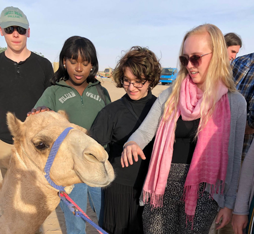 A prize-winning camel with their adoring fans.