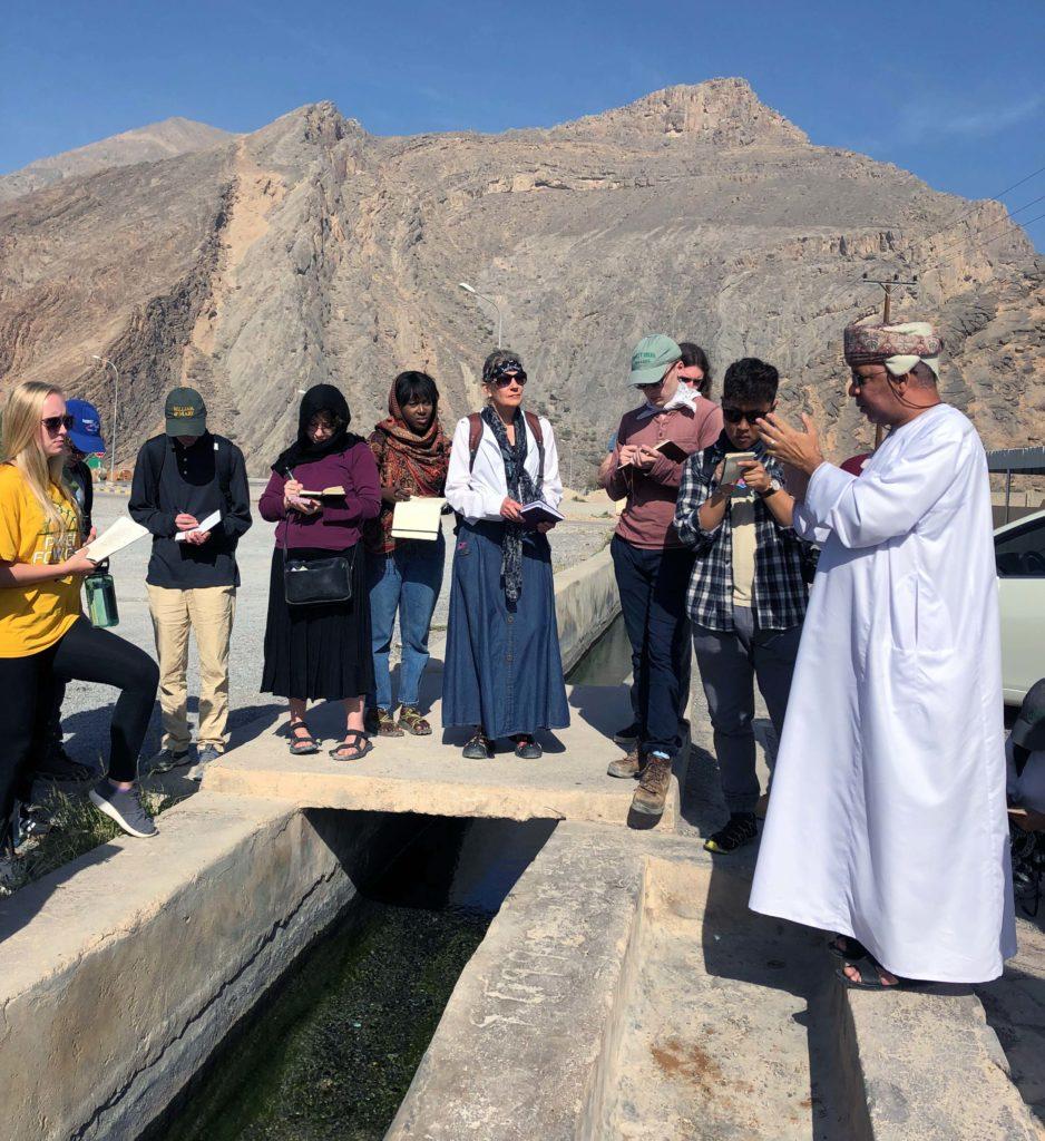 Dr. Abdullah discusses the falaj at Birkat al Mouz.