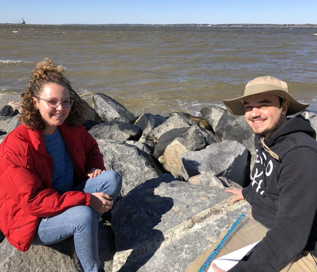 Claire Rae and Gabe Mojica examining geologic structures in the rip-rap along the York River.