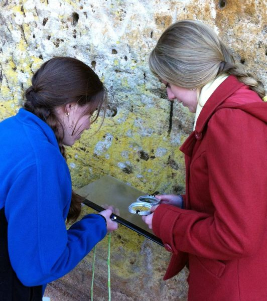 Katharine Celata and Monica Stone with compass plate and Brunton measuring the orientation of inclined strata at Cornwallis Cave (2012).