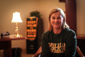 Coach Jill Ellis '88 wearing a William & Mary sweatshirt