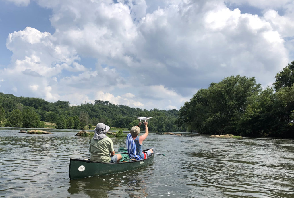 Pete Berquist '00 and Sam Belding '20 launching a drone from a canoe on the James River during the summer of 2019.