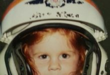Young girl in Coast Guard flight helmet