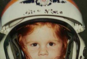 Young girl in Coast Guard flight helmet