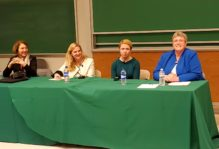 Panelists at a table, from left to right: Anne-Marie Slaughter, Sarah Glass, Anne Coleman-Honn, Sue Peterson