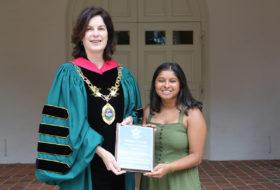 President Katherine Rowe presents Sonia Kinkhabwala '21 with community service award