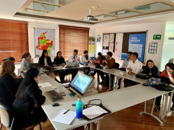 Students and IMMAP employees working in Bogotá office