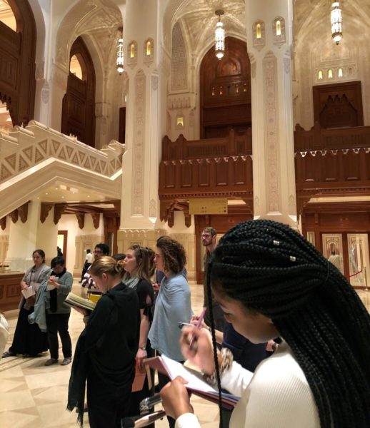 Students taking notes at the Royal opera House, Muscat.