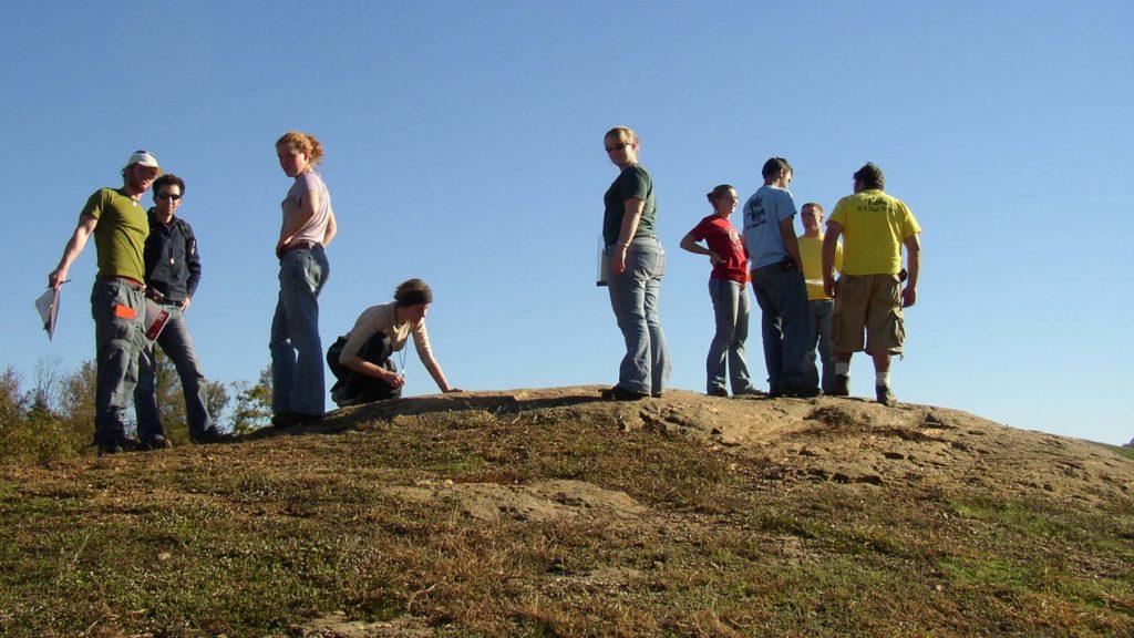 Students on an outcrop at Hidden Rock park.