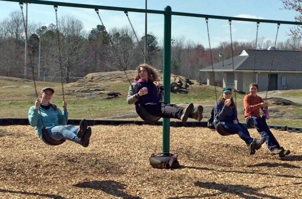 W&M students on the swings at Hidden Rock Park.