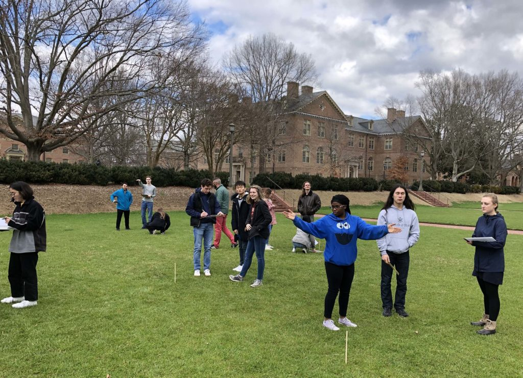 W&M students in the Sunken Garden with stakes in the ground.