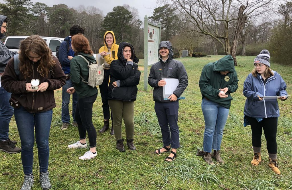 W&M students out in the field on a wet day.