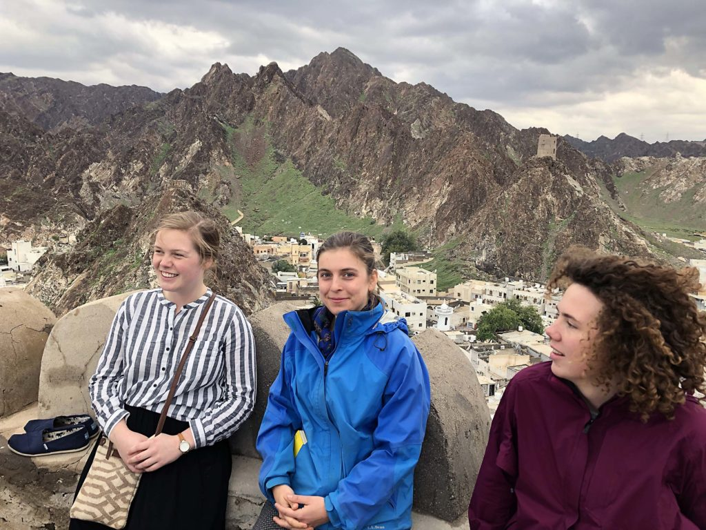 W&M students atop a castle in Oman.