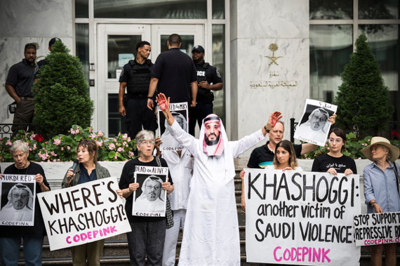"Protesters holding signs reading ""Where's Khashoggi? Codepink"" and ""Khashoggi: another victim of Saudi violence. Codepink"""