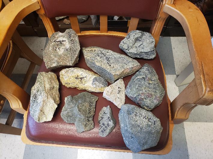 Ten metamorphic rock samples in a chair