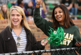 students cheering at a Tribe Football game