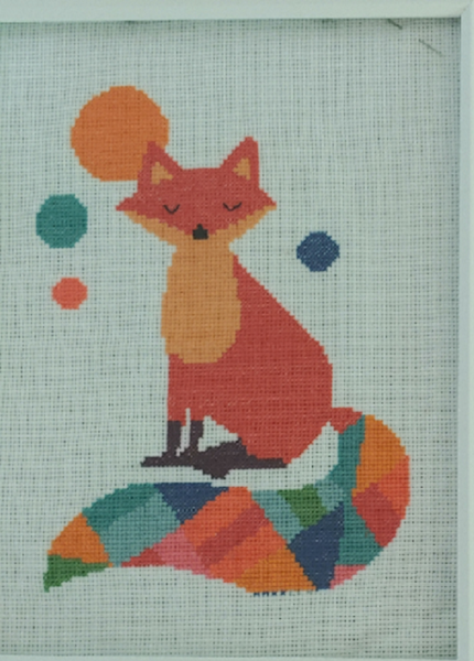 cross-stitch of a fox with four floating circles around it