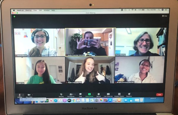 Zoom call with six smiling people in the video window